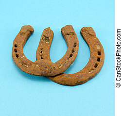 retro rusty pair upturn horseshoes blue background - retro...