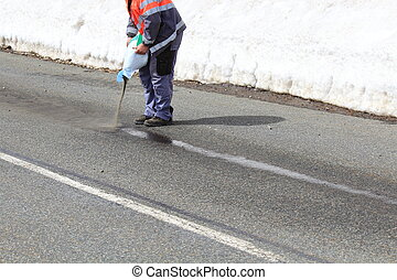 Road maintenance cleaning a Trace of oil in winter