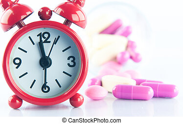 Red clock and medicine background show medicine concept