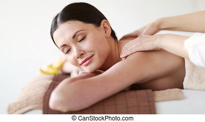 happy woman relaxing in spa salon - footage of happy woman...