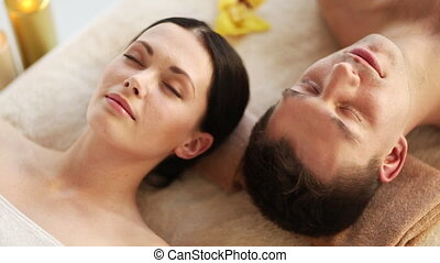 happy couple relaxing in spa salon - footage of happy couple...