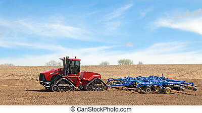 Red Tractor and Plow - Red tractor pulling a plow in a farm...