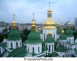 Green and golden domes of St Sophias Cathedral in Kiev,...