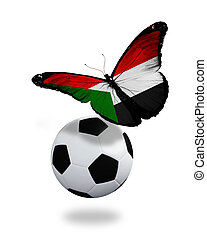 Concept - butterfly with Sudanese flag flying near the ball,...