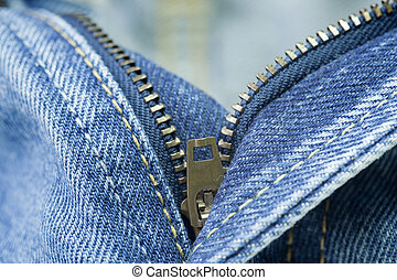Close up of the blue jeans zipper