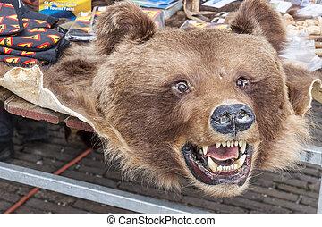Bear pelt on street market - Schokland, Holland.