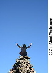 business freedom - Businessman sit on rock and open arms...
