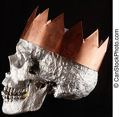 skull - A human skull with a copper notched crown on black...