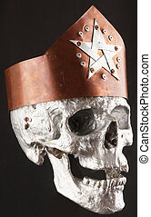 skull - A human skull with a copper crown and a pentagram on...