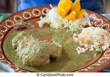 rico pollo en mole verde - A typical mexican dish of chicken...