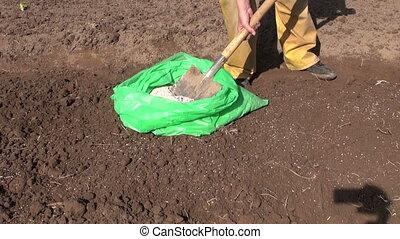 fertilize garden soil with ash