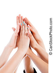 Togetherness Power Unity - Team members' hands together as...
