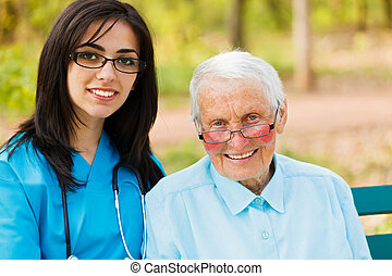 Portrait of Nurse and Elderly Patient - Kind elderly lady...