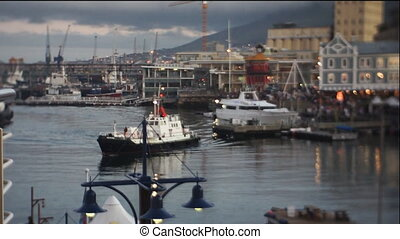 ship docking at the harbor - ship sails throught cape town...
