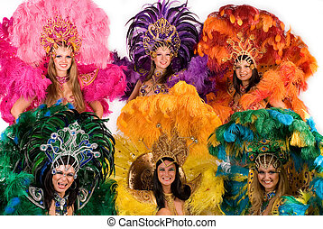 Carnival dancers in colorful and ornate costumes, studio...