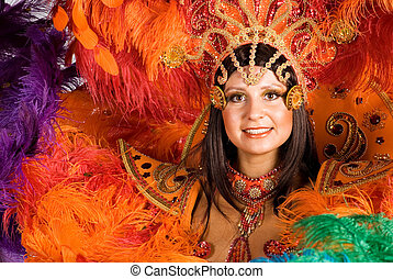 Carnival dancer - Portrait of young woman in orange carnival...