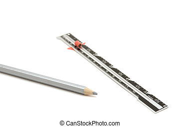 sewing centimeter and pencil closeup - object on white -...