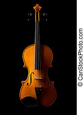 Violin on black background with selective side light