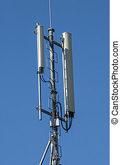 Mobile phone service antenna on blue sky background