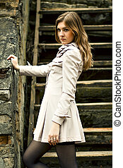 Girl is standing on the old steps
