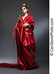 Middle Ages. Magic. Lordly Woman Wizard in Red Pallium with...