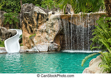 Swimming pool with waterfall and slide at high resolution -...