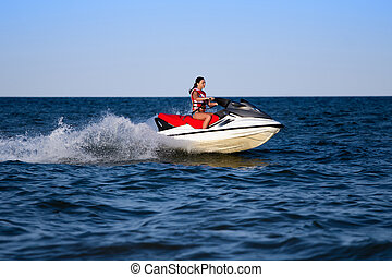 Young caucasian woman in life jacket on a wave runner