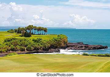 Golf course and the ocean in the background - Golf course...