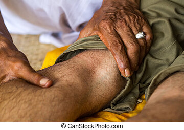 Balinese healer's hands to massage your legs - Balinese...