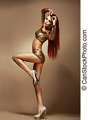 Dance Nightclub Gorgeous Redhead Woman in Golden Shorts...
