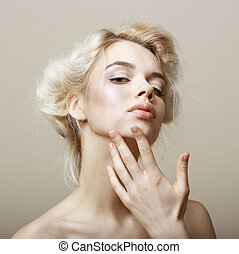 Sentimentality Natural Blonde Woman touching her Clean Face...