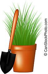 Garden trowel and grass