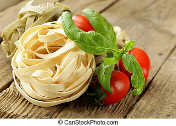 types of pasta on a wooden table