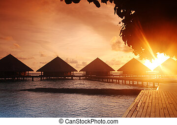 tropical island sunset - Beautiful sunset on a tropical...