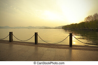Hangzhou at sunset West Lake - Sunset of West Lake in...