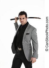 Handsome elegant man with sword