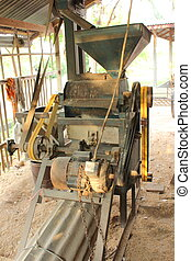 Old village rice mill removing the chaff, bran and germ to...