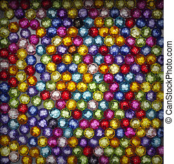 Colorful beads on black background