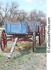 Old western wagon. - Old western wagon displayed outdoors.