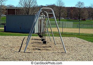 Swing set - A swing set in a park