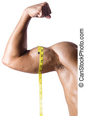 Muscular man measuring his muscles