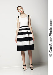 Elegant Woman Fashion Model in Light Striped Cotton...