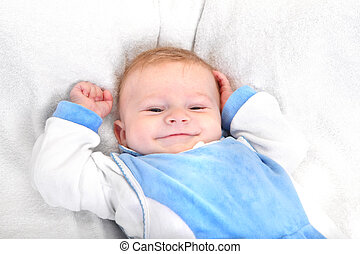 Happy Baby Boy Portrait on the White blanket