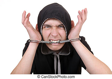 Man Gnaw a Handcuffs - Angry Man Gnaw his Handcuffs Isolated...