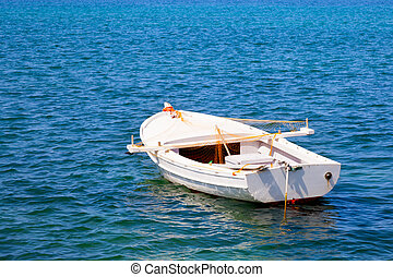 Boat in water. Old wooden boat