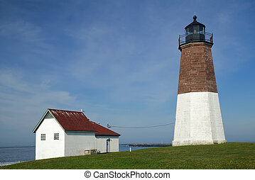 The Point Judith Light on the Rhode Island coast - The Point...