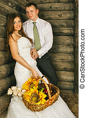 Bride and Groom - charming bride and groom in hayloft at...