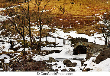 View of High Sweden Packhorse Bridge - Snowy winter view of...