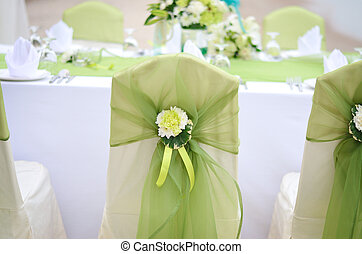 Wedding chair decorated with green color and flower