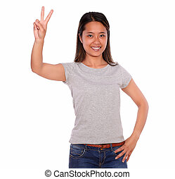 Ethnic smiling young woman celebrating a victory - Portrait...